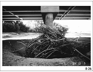 This photo shows bridge scour increased by debris at a bridge on the Rio Grande near Bernardo, New Mexico.