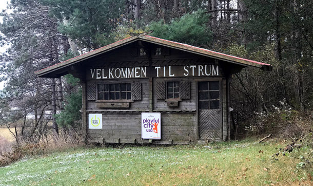 Village of Strum welcome sign, stating Velkommen Til Strum.