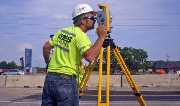 Ayres surveyor using tripod mounted equipment