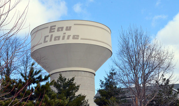 Eau Claire water tower above the treeline. For the City of Eau Claire, Wisconsin, Ayres designed a 1.5-million-gallon water tank located in a west-side high-pressure zone, an area that includes two business parks.