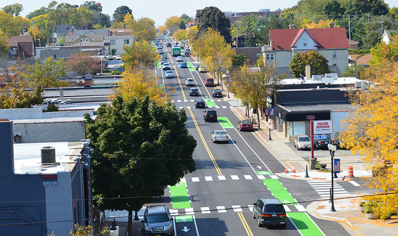 Aerial photo looking down a complete street with painted bike lanes.
