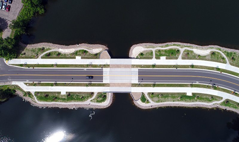 Aerial Shot of a bridge featuring a complete street with enhanced landscape aesthetics.