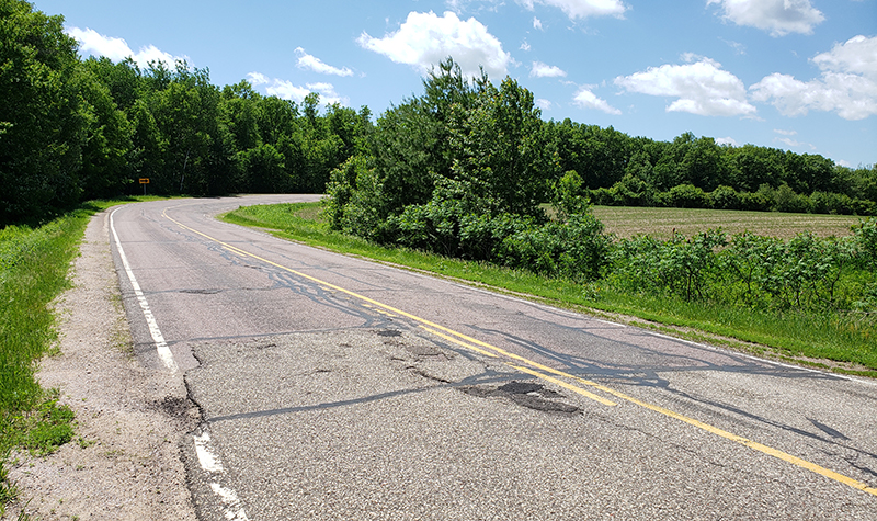 weathered road possible candidate for mill and overlay